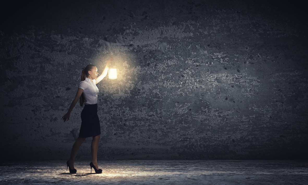 Business woman with lantern